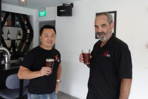 Photo of two people drinking beer